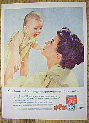1955 Carnation Milk With Mother Holding Up Baby