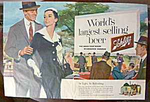 1956 Schlitz Beer With Man & Woman Walking Together