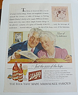 1943 Schlitz Beer W/older Couple Looking At Photo Album