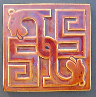 Maw Geometric Tile With Opposing Dogs Heads