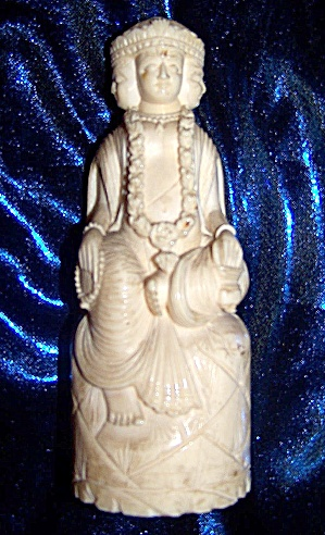 Ivory Figurine Of Seated Oriental Man With Four Faces.