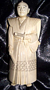 Ivory Figurine Of Robed Oriental Man With Sword.