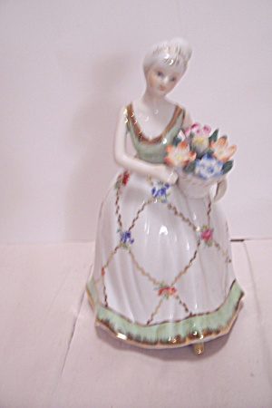 Beautiful Hand Painted Young Lady Figurine