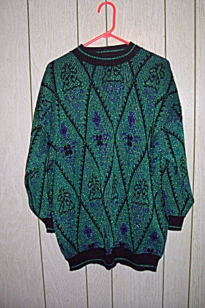 Distinctly Different Green Sweater With Black Trim