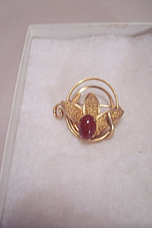 Gold Tone Brooch With Oval Amber Cabachon