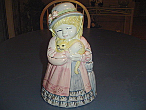 Old Fashioned Little Girl Holding A Cat Cookie Jar