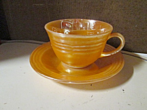 Fire King Peach Lusterware Cup & Saucer Set
