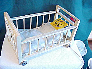 Antique Doll Crib W/wheels And Squeeker