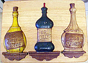 Sexton Three Metal Bottle Wall Plaques