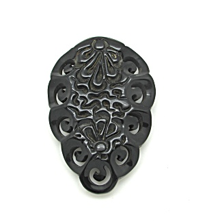 Black Carved Bakelite Dress Clip