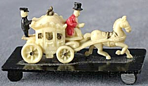 Vintage Celluloid Stagecoach On Black Base