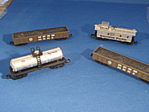 Four Miniature Train Cars