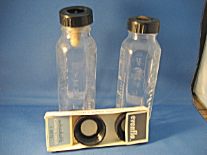 Two Evenflo Glass Bottles And Caps
