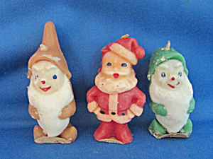 Two Christmas Elves And One Santa Figurine Candles