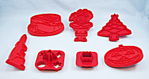 Four Red Tupperware Cookie Cutters